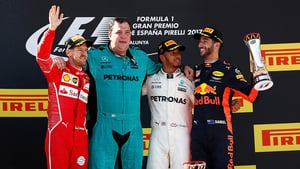 Hamilton wins after strategy battle with Vettel