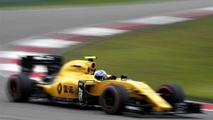 Jolyon Palmer picks up a puncture in final practice