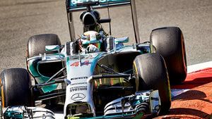 Lewis secures pole for Mercedes