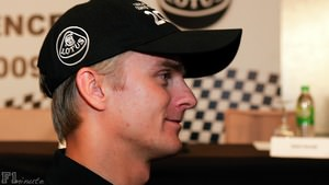 Heikki Kovalainen gets his Lotus gear on
