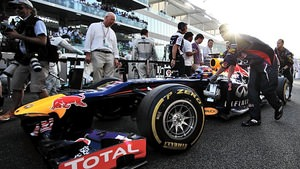 Webber's car is pushed to the grid