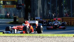 Felipe Massa battles Jenson Button during Australian GP