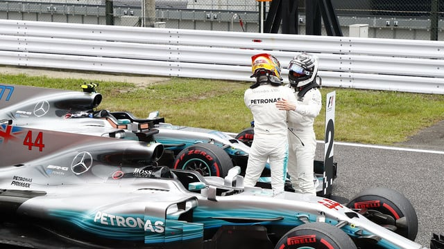 Hamilton scores another pole as Grosjean crashes out