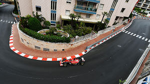 Alonso threads his Ferrari around the streets of Monaco