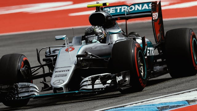 Rosberg fastest in German practice as Button heads to the hospital for an eye check