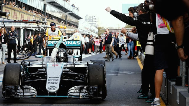 Rosberg wins chaotic opening race as Alonso walks away from huge crash