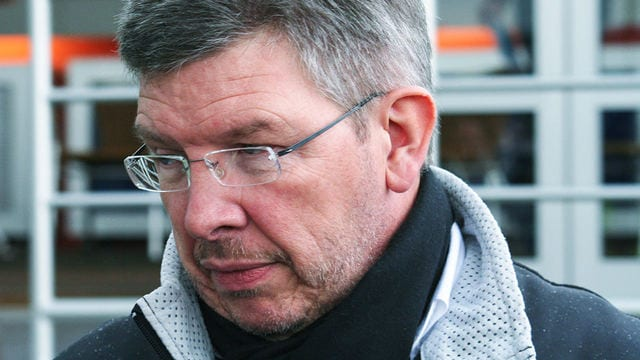 Ross Brawn of Mercedes signs memorabilia for fans