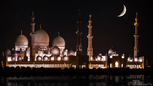 The moon lights up the Sheikh Zayed Grand Mosque