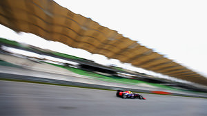 Vettel makes his way around Sepang
