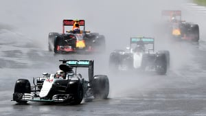 F1 cars kick up spray during the British Grand Prix