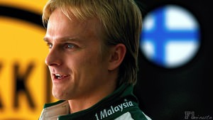 Heikki Kovalainen waits in the garage during Bahrain practice